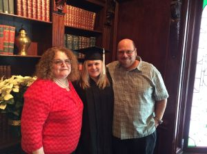 Daughter Veronica with my husband Rick and me at her college graduation