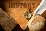 History etched on an old paper scroll with a feather quill and compass