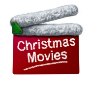 Christmas movies and holiday classic cinema and TV flicks with a red clapperboard and a Santa Clause hat white fur trim as an entertainment symbol of the winter film industry cinematic releases on a white background.
